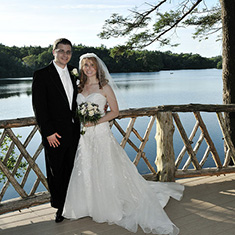 Bride and groom portrait on a pond